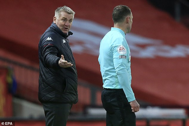 Dean Smith (left) claims Man United's crucial penalty against Aston Villa should not have stood