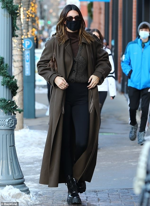 Chic: Kendall looked stylish in a more reserved brown overcoat that accentuated her 5ft10in stature