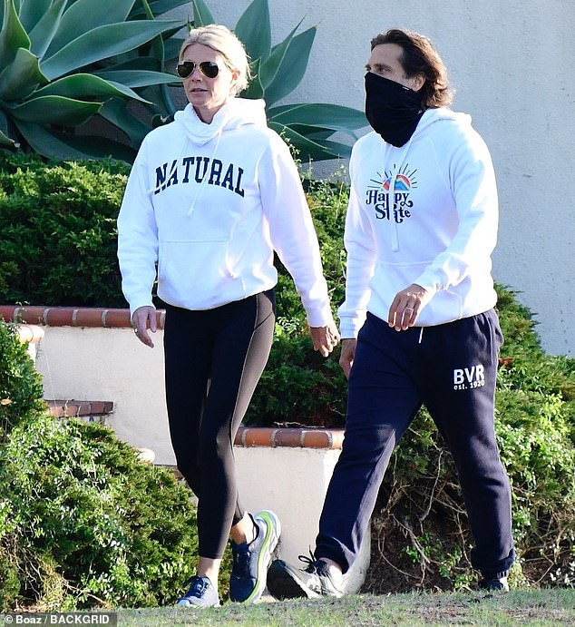 Out and about: Gwyneth Paltrow, 48, matched her husband Brad Falchuk, 49, in sweats as they went for a stroll in their Brentwood neighborhood on New Year's Day