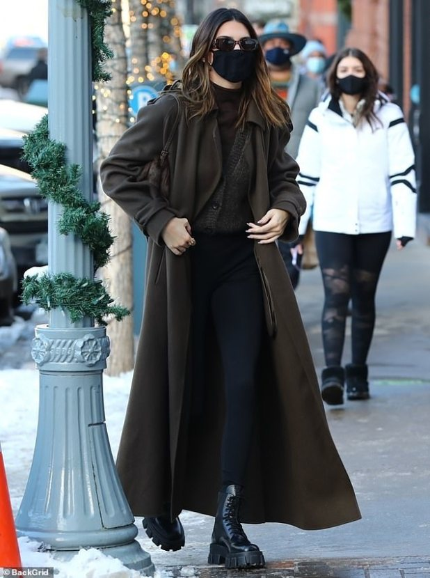 Toasty :: She's buttoned-up with a gray cardigan and brown mock turtleneck, underneath with high-waisted black leggings