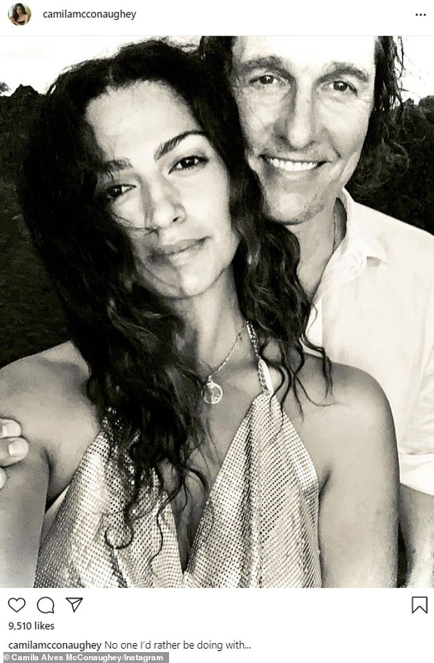 'No one I'd rather be doing with...': Camila Alves cuddled up to her husband Matthew McConaughey in a snap she shared to Instagram on Saturday