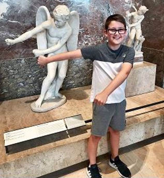 Above, Harley at the Louvre during a trip to Paris with his mother. Jo believes the NHS should be held accountable for failing to detain Glover under the Mental Health Act on five separate occasions, including just nine weeks before Harley's death