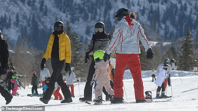 Little shredder: Kylie Jenner's daughter Stormi, two, gets another snowboard lesson on Buttermilk Mountain in Aspen as Kendall, Kris, and Kylie watch on