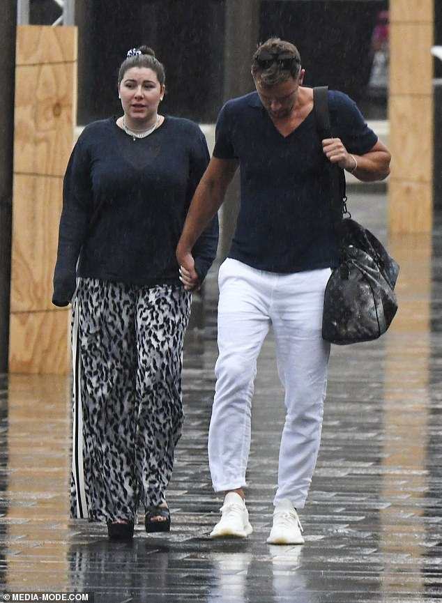 Francesca Packercosies up to her new Pilates instructor boyfriend Adam Cooper on New Year's Day
