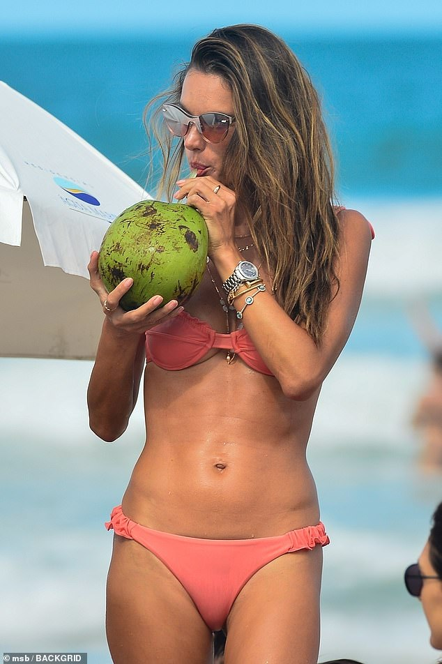Alessandra Ambrosio shows off her fit physique in a tiny pink bikini during beach day in Brazil