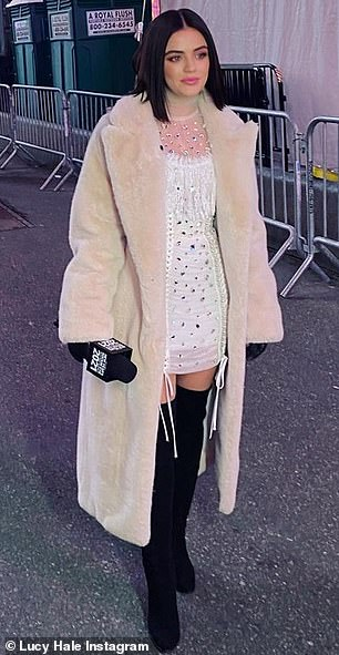Black and white: She also donned a similar look in white