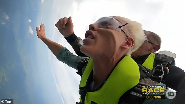 In for a challenge: Jack, Paulini Curuenavuli and former The Block star-turned-radio host Jess Eva were required to jump 14,000 feet out of a helicopter into a lake, and Jack wasted no time in getting strapped into his harness