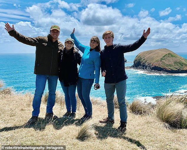 United: Bindi, Rob, Chandler and Terri appear to have gone hiking on their holiday for New Years, with the family visiting mountain tops and walking along ocean clifftops