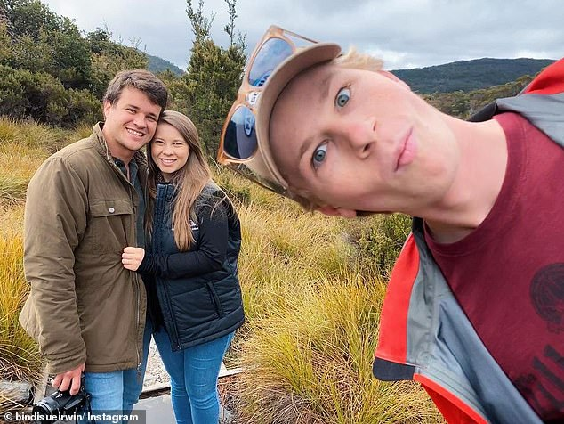 Front and centre! On Sunday,Robert Irwin photobombed sister Bindi and her husband Chandler Powell while on holiday in Tasmania