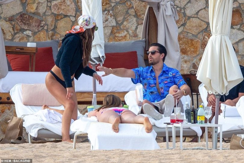 Don't go!: Scott reached out for Amelia as she got up from the lounge chair
