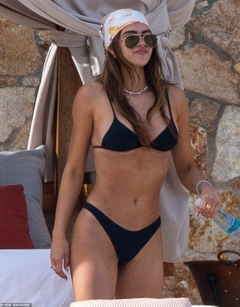 Amelia Gray Hamlin puts on a cheeky display in black string bikini on vacation with Scott Disick