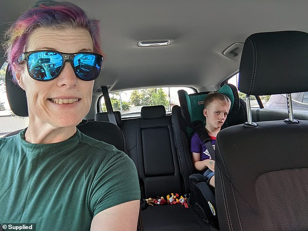 Emma (left) and her five-year-old son (right) sitting in the car after she used a bug bomb to kill the baby spiders and cleared away their spider silk