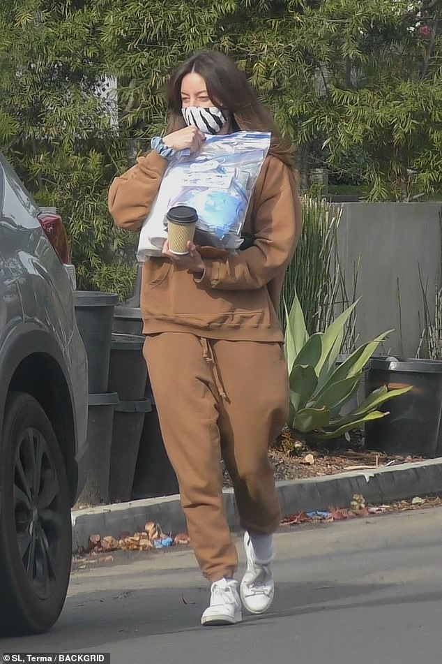 Staying safe: Plaza, 36, donned a zebra-patterned face mask as COVID-19 cases continue to surge in Southern California despite a safer-at-home order