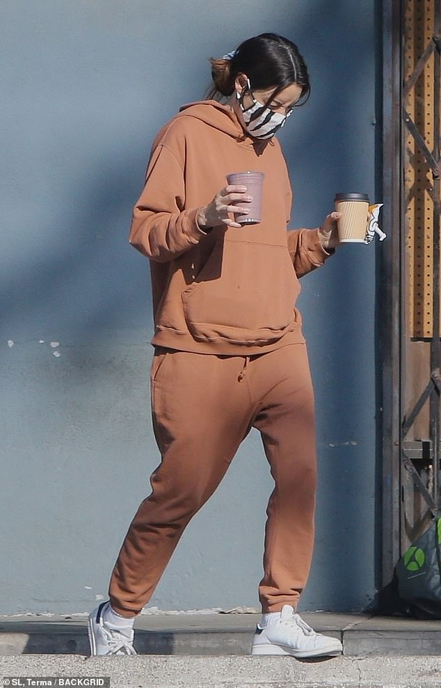 Errand: Aubrey Plaza, 36, kept it casual as she grabbed some coffee to go in matching hoodie and joggers in Los Angeles on Sunday