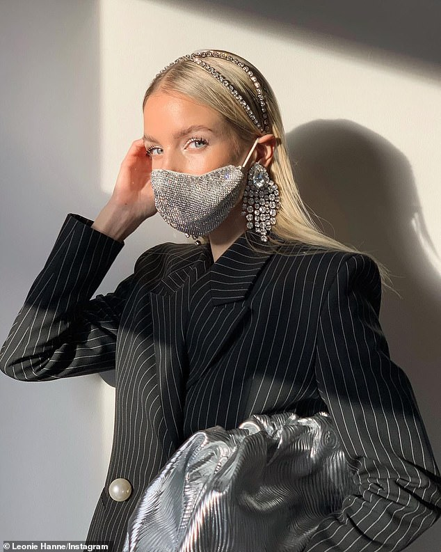 German fashion influencer Leonie Hanne wears a $49 sequined mask from Hong Kong clothing brand WEAT - an acronym for We Eat Avocado Toast