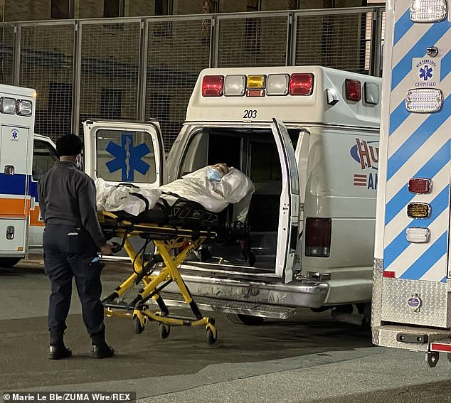 COVID-19 hospitalizations have surged in New York by almost 80 percent in the past four weeks, as the state battles a second wave of infections. A patient is seen being taken into hospital via ambulance in New York City on New Year's Eve