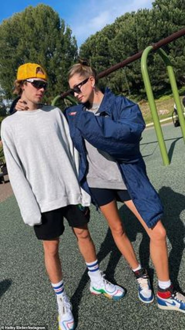 Twinning:Justin's wife Hailey, 24, took notes from her husband of two years as she posed for a snapshot next to him in a pair of short shorts of her own
