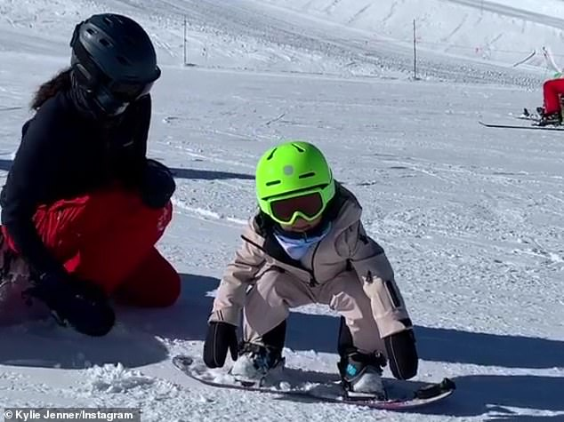 Picking up speed: Stormi squatted down on her knees to get going, before she picked up speed down the hill, as she could be heard softly exclaiming: 'Weee!'
