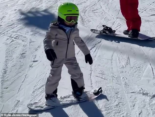 Snow pro: Kylie Jennergushed over daughter Stormi, who graduated from the bunny slopes Sunday, as the 'little pro' showed off her snowboarding skills in an adorable video on Instagram