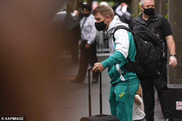 Game time!The 35-year-old sports star pulled a black suitcase with one hand and held his third daughter Isla Rose Warner's hand after checking out of the Park Hyatt in Melbourne