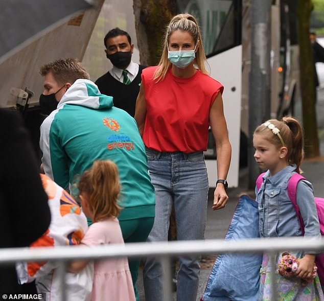 Family support: David Warner had his hands full as he travelled to Sydney with his wife, Candice, and their daughters on Monday. Pictured leavingthe Park Hyatt hotel in Melbourne