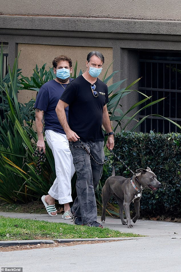 The latest: Jonah Hill, 36, was snapped taking out his dog for a walk, along with a dog trainer, in his Los Angeles neighborhood on Sunday