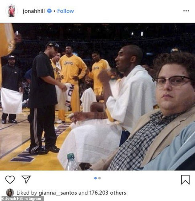 Hill shared a shot of himself sitting courtside at a Los Angeles Lakers game with late legend Kobe Bryant prominently in the background, that his late brother Jordan snapped