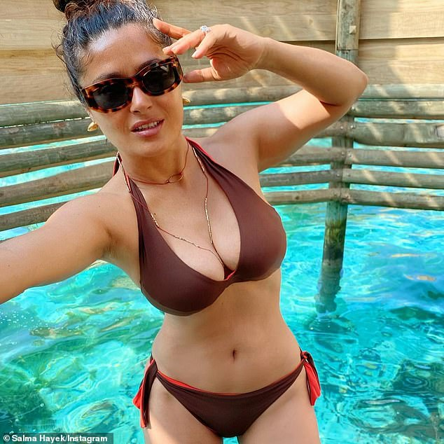 Stunning: Salma Hayek treated her fans to another visual delight, when she returned to the image-sharing platform to post a photo of herself posing in a skimpy bikini on Sunday