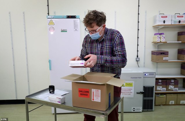 Among those to be vaccinated with the Oxford/AstraZeneca jab from next week will be vulnerable NHS staff and social care workers who are at risk. Pictured: Assistant Technical Officer Lukasz Najdrowski unpacks doses on Monday