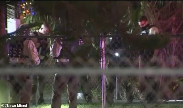 Eight people were shot and six have been left in a critical condition, including one 16-year-old boy who was airlifted to a nearby hospital. Pictured: Police at the scene