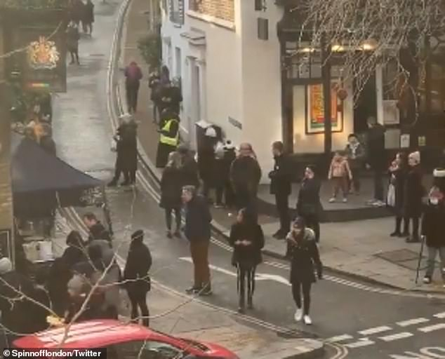 Twitter user Spinnofflondon tweeted a series of videos filmed from opposite, including the one above, showing a police van at the scene as huge numbers of people stood outside the stalls