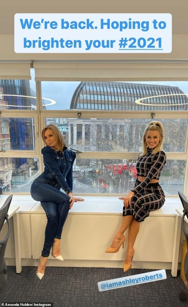 Glam gals: While inside the studios, Amanda posed for a socially distanced snap with her fellow Heart presenter, Ashley Roberts, 39