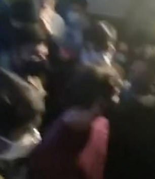 Footage taken at the event shows scuffles breaking out among the crowd before Mr Faruqui and his colleagues Edwin Anthony, Prakhar Vyas, Priyam Vyas, and Nalin Yadav were taken into custody