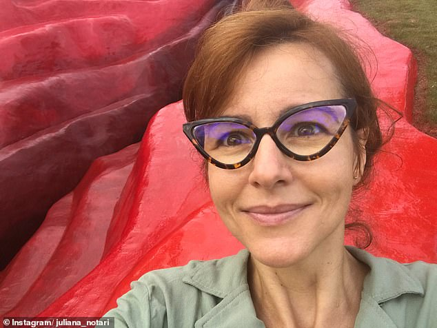The scarlet sculpture, titled 'Diva', stretches for 33 metres and was built into the hillside with the help of diggers. Visual artist Juliana Notari is pictured above