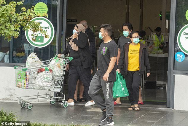 Shoppers leaving Woolworths Berala are seen wearing masks on January 3. The venue is now at the centre of a potential Covid outbreak - with thousands told to isolate