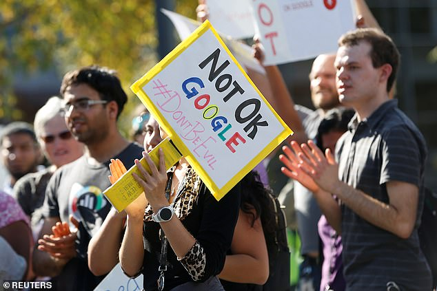 A Google employee holds a sign that says 'Not Ok Google, #DontBeEvil' during the November 2018 'women's walkout' to protest the company's handling of sexual harassment cases in Mountain View, California