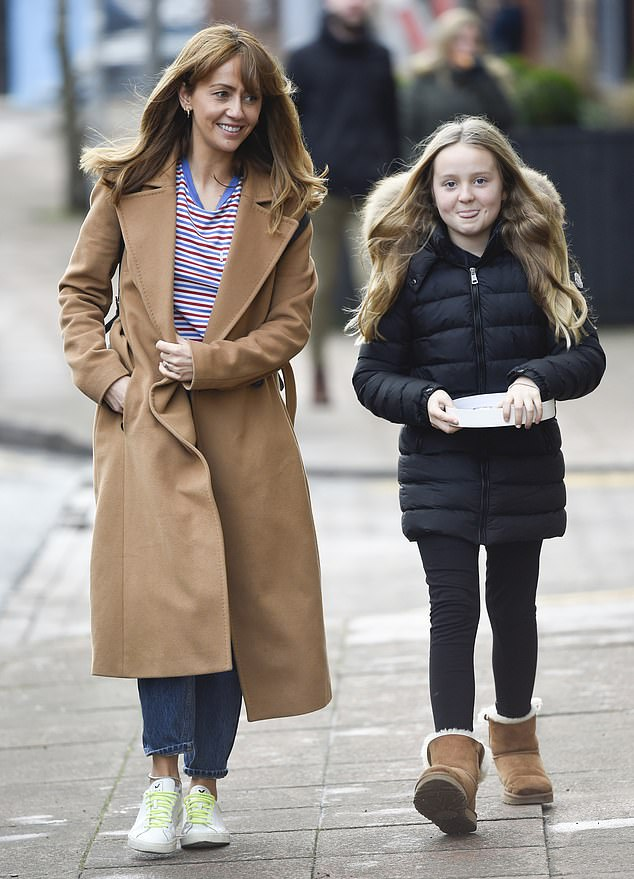 Family time: Samia Longchambon, 38, beamed with happiness as she was joined by daughter Freya, 11, for a winter stroll in Wilmslow, Cheshire, on Monday