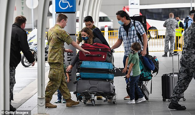New South Wales has narrowly avoided catastrophe four times in the last month due to Covid breaches in the hotel quarantine system for returned travellers (pictured, returning travellers at Sydney airport)