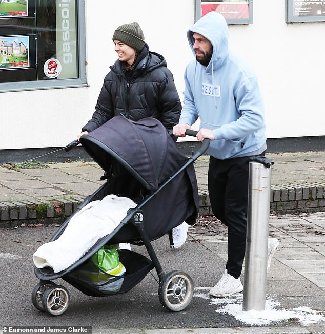 Doting dad: Kelvin Fletcher was on daddy duty as he stepped out with his wife Liz and their son Milo, 22 months, in Cheshire on Monday