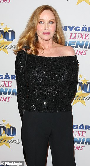 You only live twice! Moment Bond girl Tanya Roberts' partner learns she is ALIVE during an interview