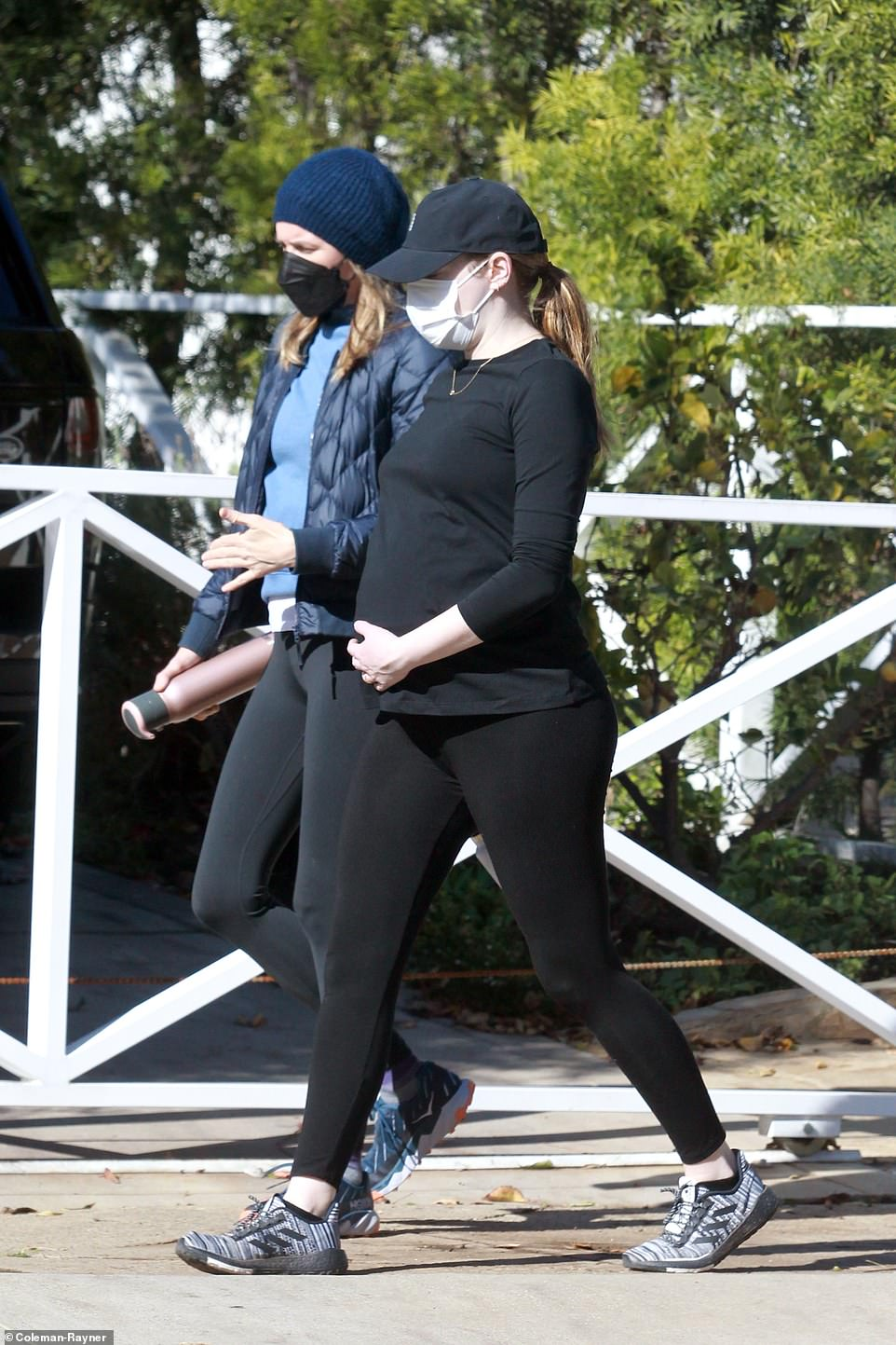 Emma Stone is spotted lovingly cradling her large belly
