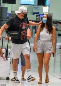 Josh Reynolds is farewelled by his doting new girlfriend at Sydney Airport as he jets to the UK