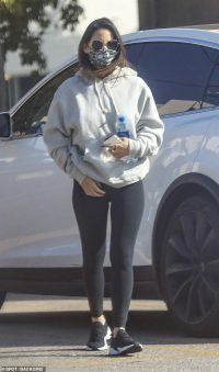 Olivia Munn cuts a casual figure in a grey hoodie and leggings as she goes to the gym