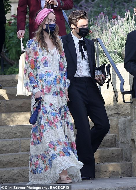 New love: The couple looked comfortable as they attended their first event together hand-in-hand