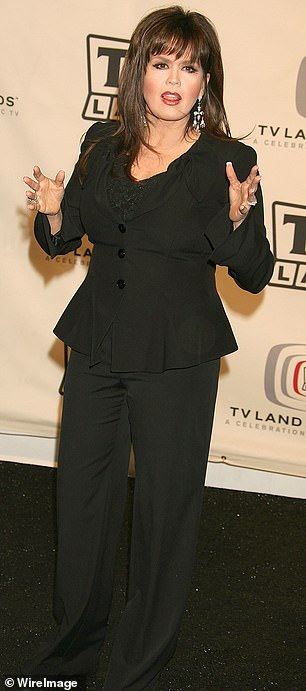 A bit fuller: The singer is seen in 2006 at the TV Land Awards where she hid her curves in a black suit