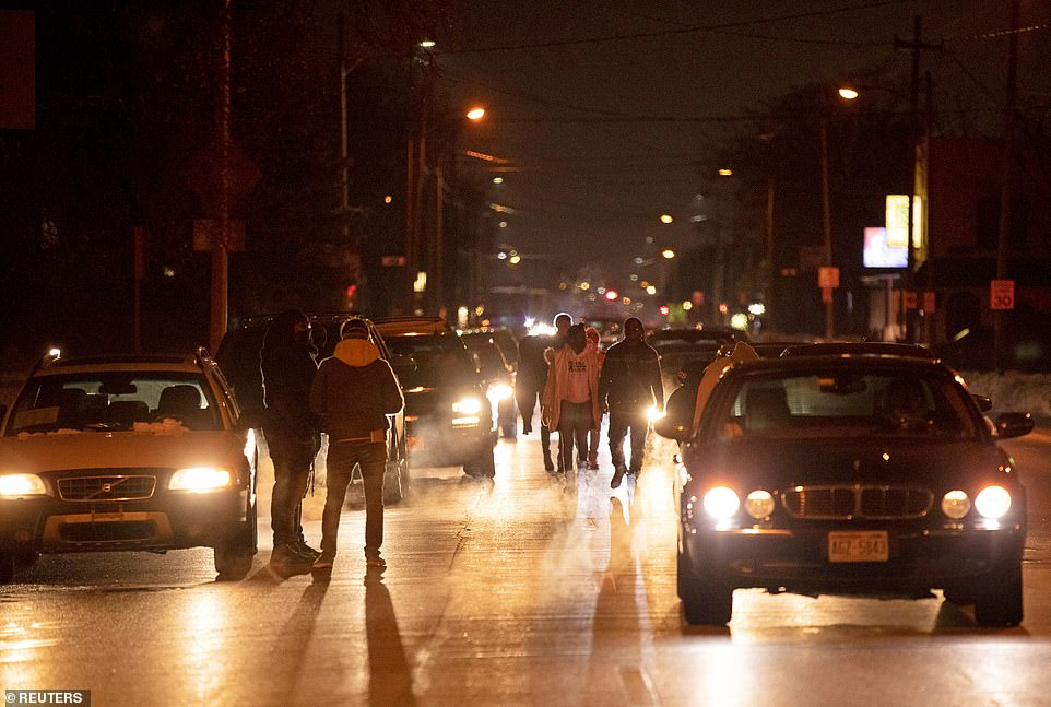 Protesters stand in the road in Kenosha as they marched through the streets demonstrating against the decision