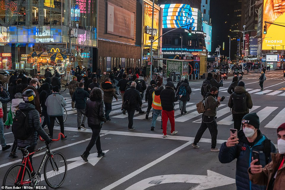 People walked and pushed their bikes through the heart of the Big Apple after the DA ruled that no charges would be brought against the white cop