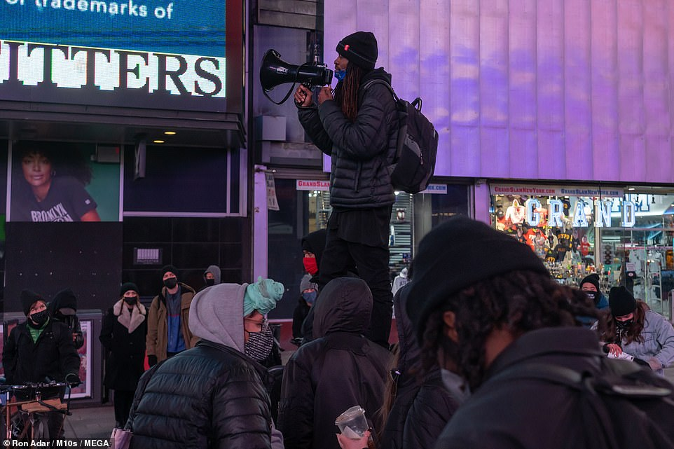 In New York City, a small group of protesters gathered in Times Square, Manhattan, Tuesday night
