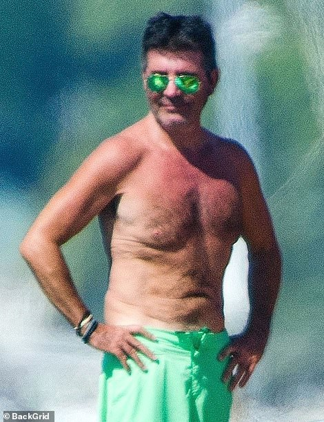 Simon Cowell displays his sunburn on third week in Barbados during a yacht day with Lauren Silverman
