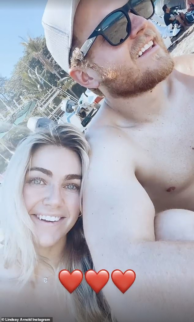 So in love: Here she is seen with her high school sweetheart turned husband on the trip